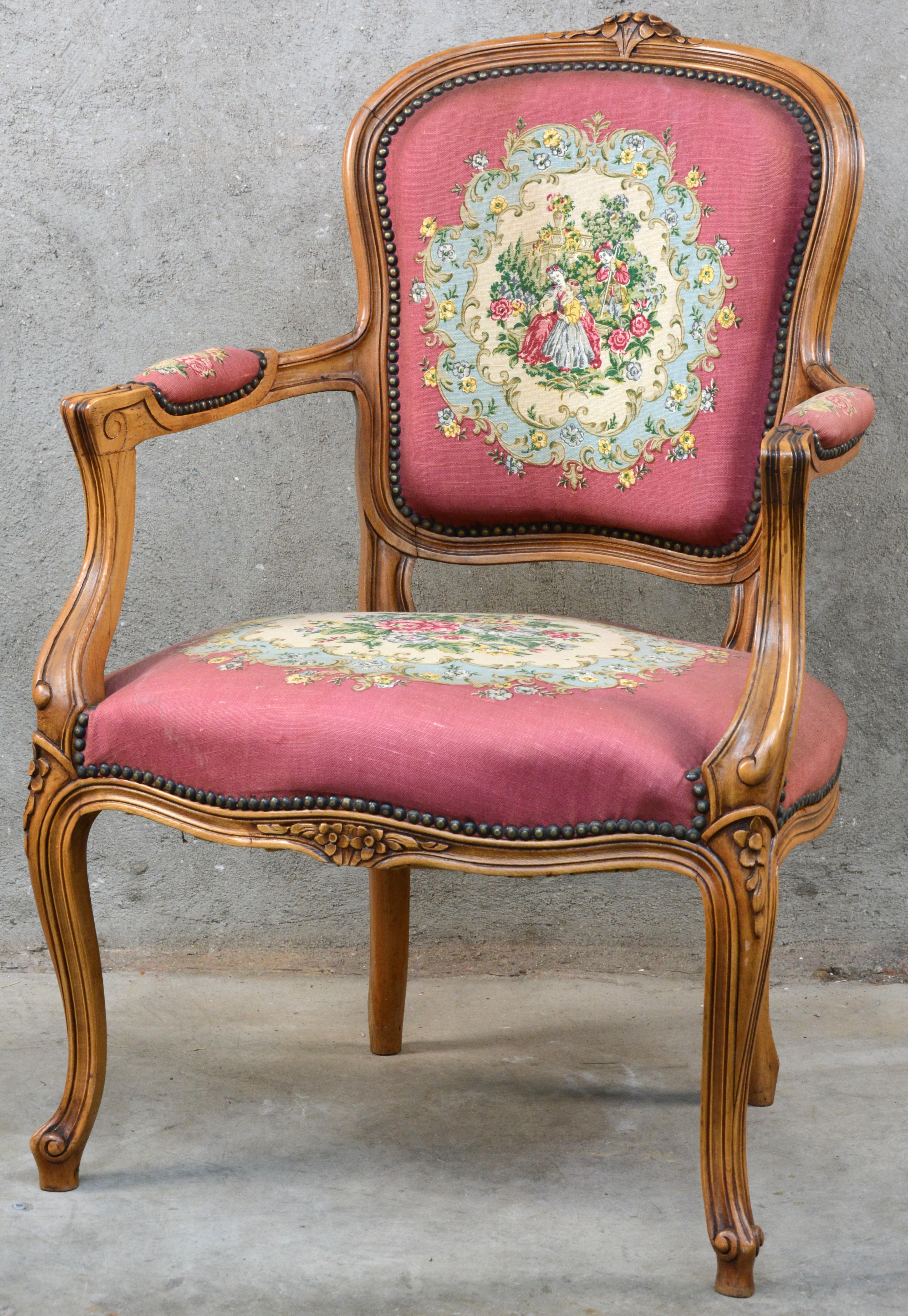 Een fauteuil en cabriolet van gesculpteerd notenhout in lodewijk xv stijl bekleed met naaldwerk - Garderobe stijl van lodewijk xv ...
