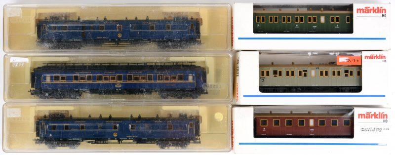 Een lot van zes wagons, spoortype HO. Modellen4210, 4211 & 4214 (Märklin) en 43397 (2X) & 3390 (Trix). Allen in originele doos.