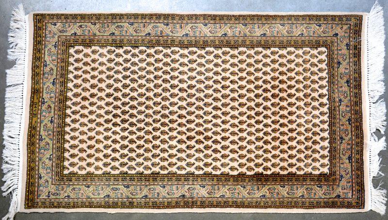 Een Indisch wollen karpetje.