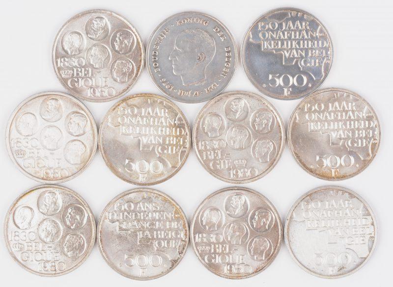 """Elf zilveren munten waaronder onafhankelijk van Belgie 1830-1980. """"L'Independance de la Belgique"""" en Boudewijn Koning der Belgen 1951-1976. In een het houten doosje met inleg van ivoor."""