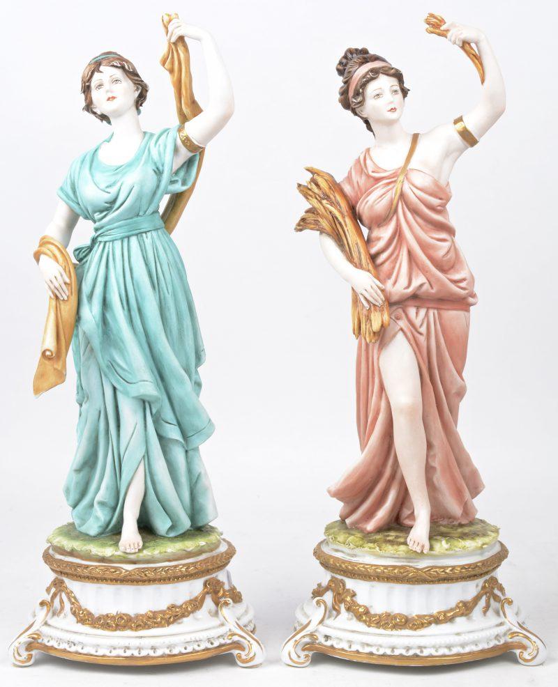 Twee classicistische vrouwen van meerkleurig biscuit. Onderaan gemerkt.