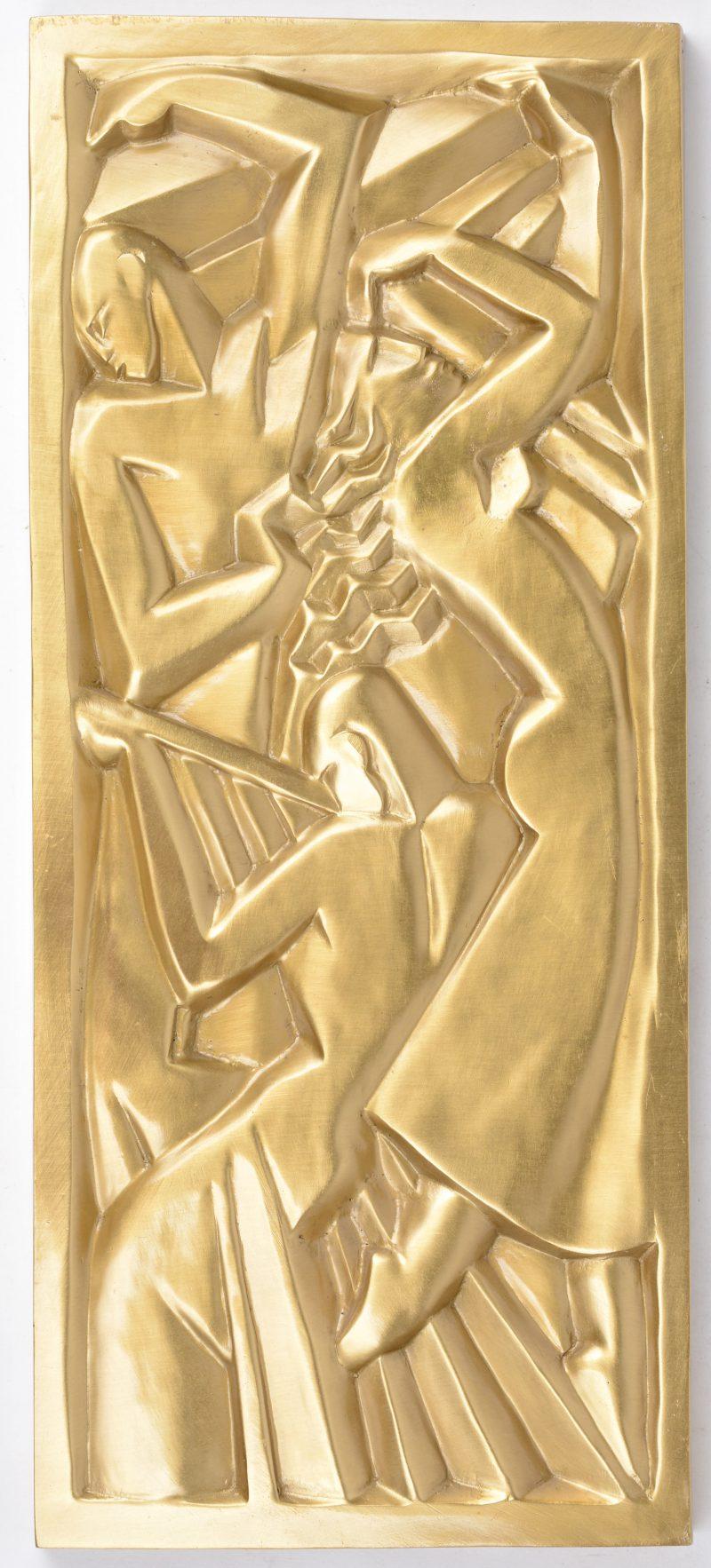 Een bronzen plaquette in art-decostijl.