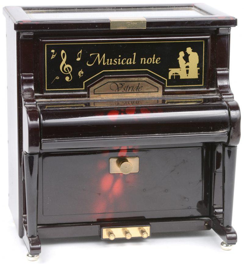 Een juwelenkistje - muziekdoos in de vorm van een kleine buffetpiano.