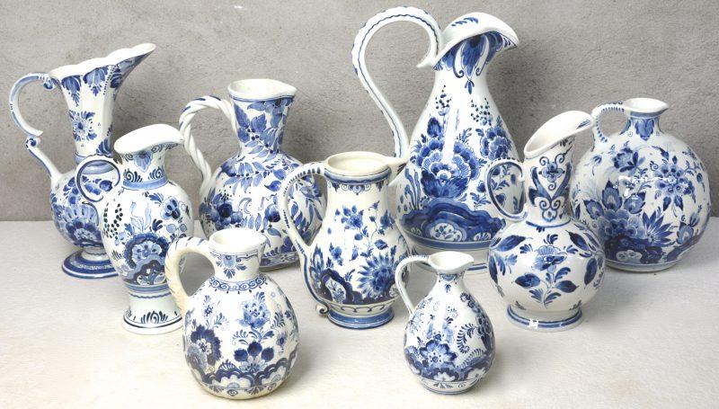 Negen verschillende sierkannen van blauw en wit Hollands plateel. Diverse merken.
