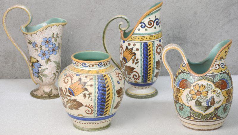 Een lot meerkleurig plateel, bestaande uit een kan en een vaas met decor 'Joma', een kan met decor 'Juan' en een kan met decor 'Majoma'. Medio XXe eeuw.