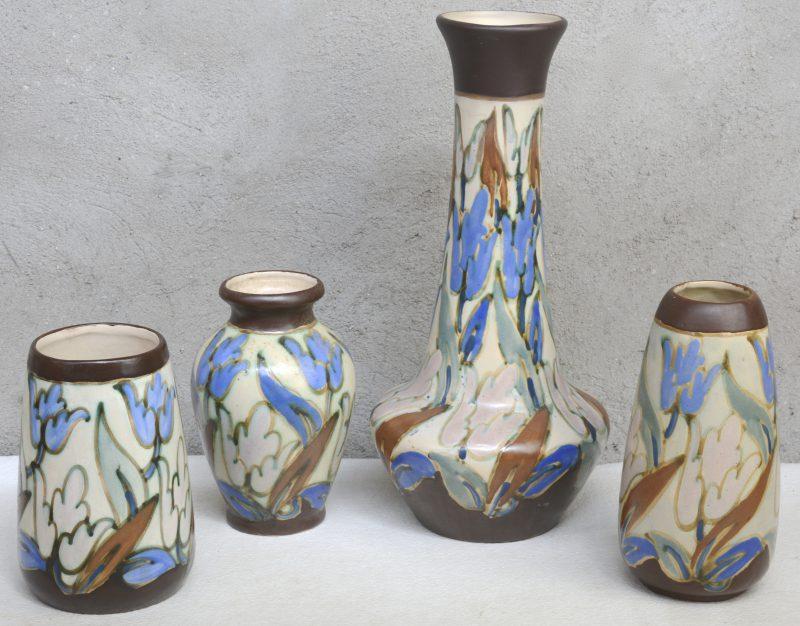 Vier verschillende vazen van meerkleurig aardewerk in de stijl van Gouda. Allen gemerkt.