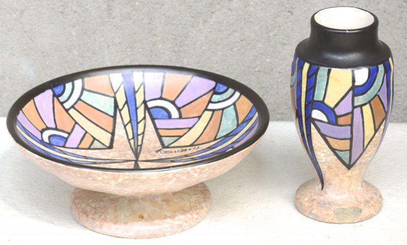 Een art deco tazza en een vaasje van meerkleurig aardewerk met decor 83 van A. Dubois. Onderaan gemerkt.