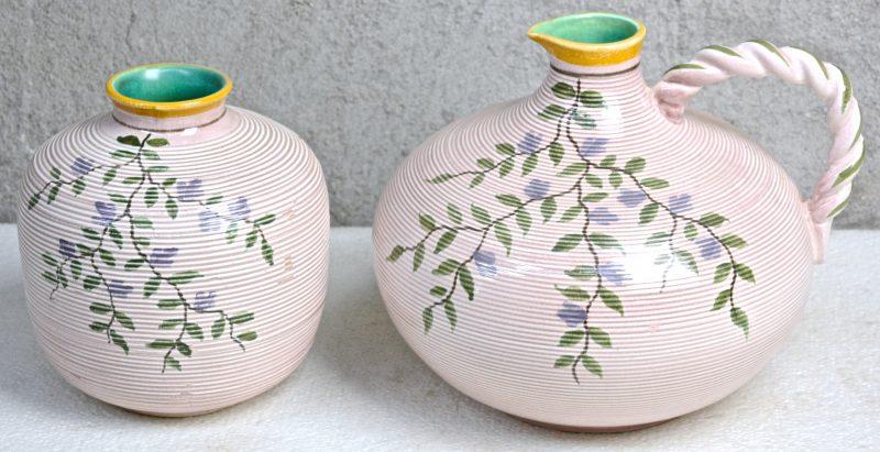Een kruik en een vaas van meerkleurig aardewerk met een decor van bloeiende takken, 'Unia'. Onderaan gemerkt.