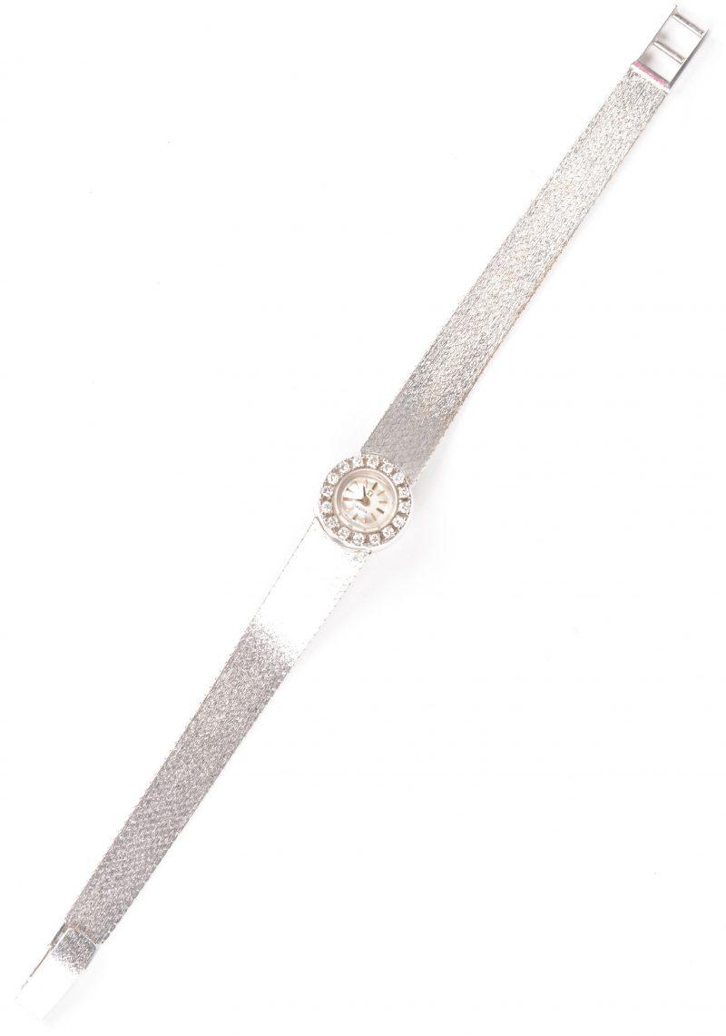 Een 18 karaats wit gouden dameshorloge en polsband bezet met diamanten met een gezamenlijk gewicht van ± 0,48 ct.