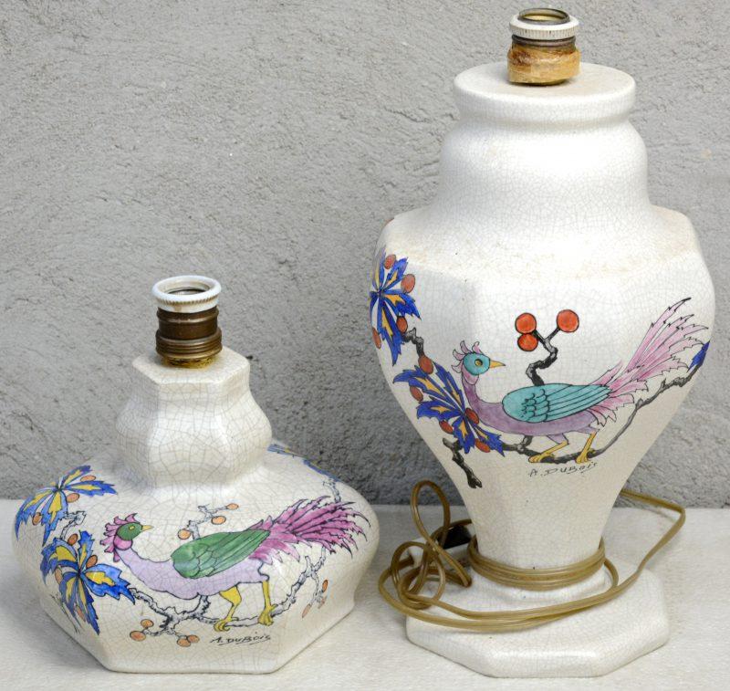 Twee lampenvoeten van gecraqueleerd aardewerk met meerkleurige decors van een vogel op een bloeiende tak. Gesigneerd 'A. Dubois'