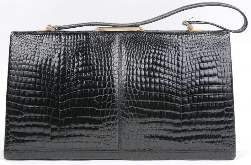 Een vintage handtas van zwart krokodillenleder. Jaren '60.