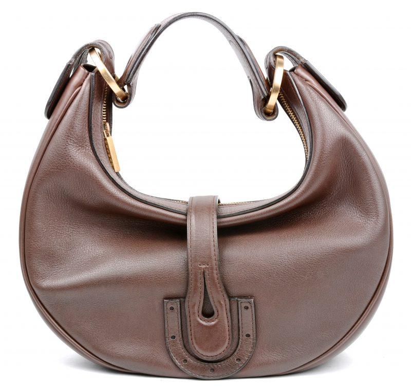 Een handtas van donkerbruin leder, model 'Camille PM'. In originele dragtas.