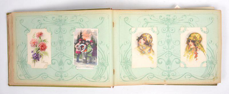 Een oud art nouveau album met wens-en fantasiekaarten, de meeste gefrankeerd en verzonden tussen 1904 en 1940, enkele tot 1953. Meer dan 150 stuks.