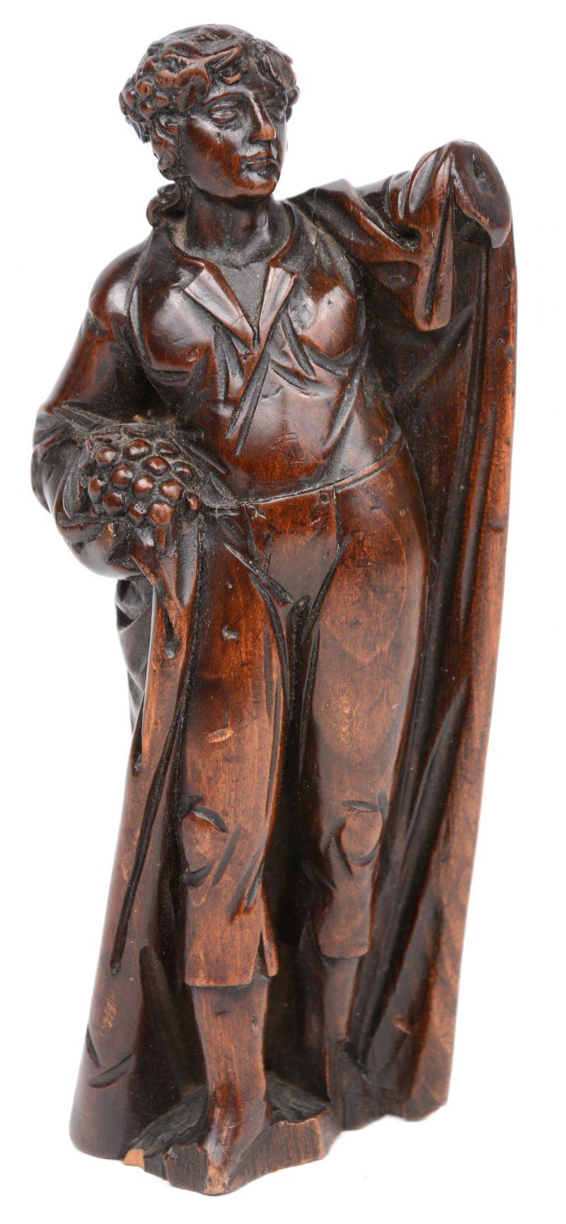 """""""Allegorie op de lente"""". Een gesneden houten beeldje. XVIIe eeuw."""