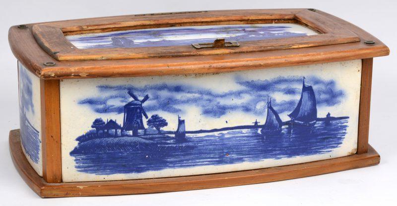 Een Hollandse broodtrommel van aardewerk en hout.