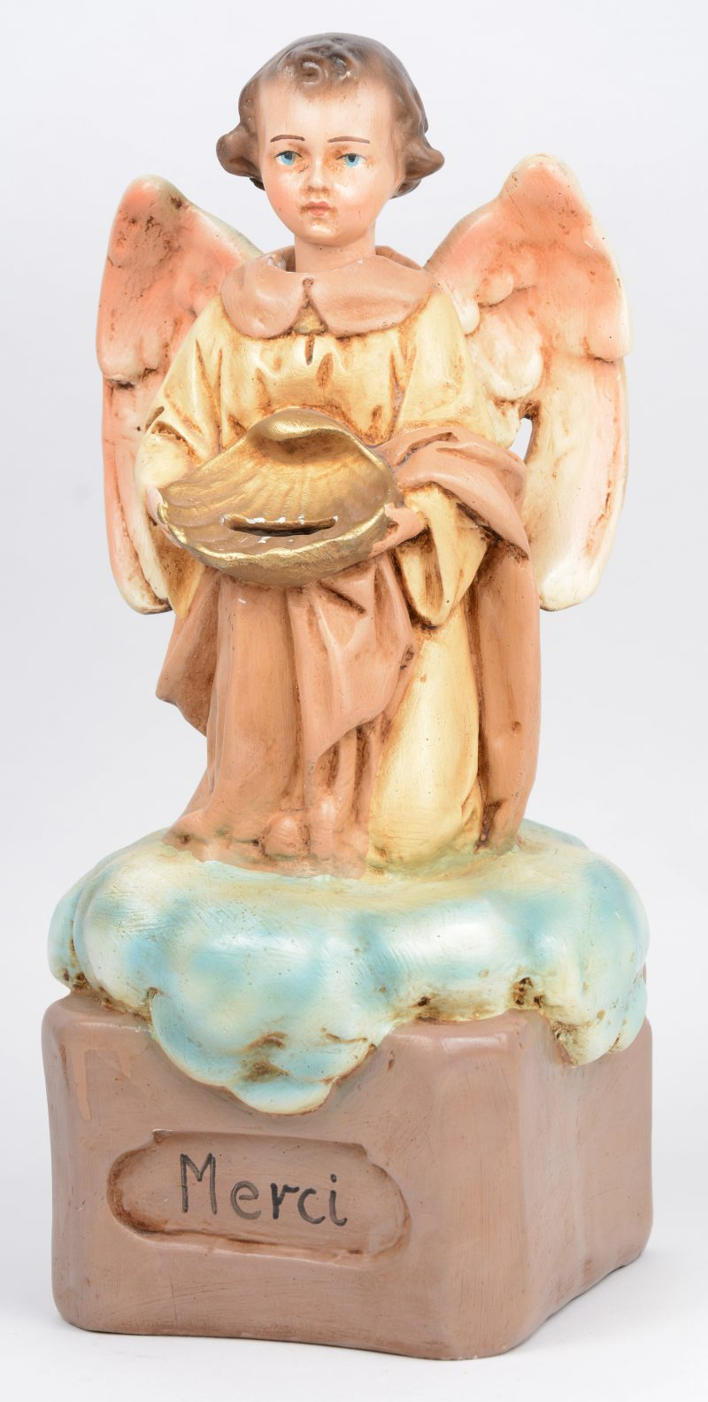 Een zg. missie-engeltje, een meerkleurig plaasteren collectebus met knikkend hoofdje.