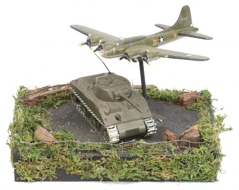 Een maquette met een vliegtuig en een Shermantank.