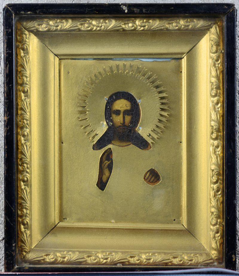 Een Oekraïense icoon met een voorstelling van Christus. XIXe eeuw. Achter glas. Zonder riza.