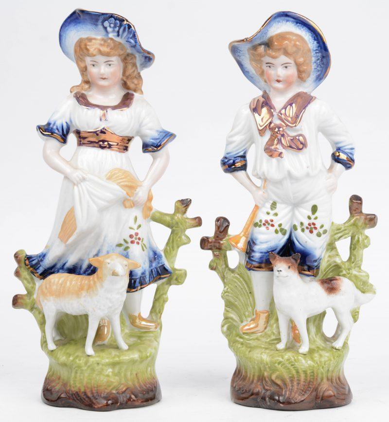 """""""Jongen met hond"""" & """"Meisje met schaap"""". Twee meerkleurig porseleinen beeldjes."""