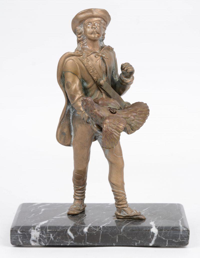 """""""Jager met korhoen."""" Bronzen beeldje op marmeren voet."""