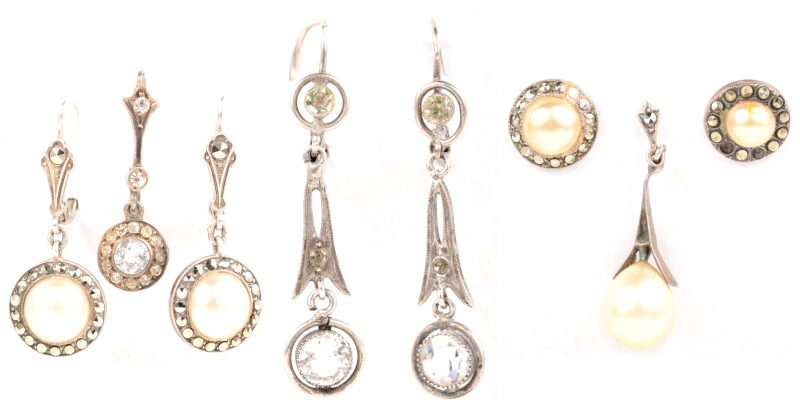 Een lot zilveren oorbellen bezet met parels en markasiet en fantasiestenen.